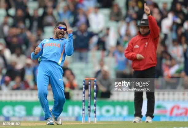 Indian bowler Ravi Jadeja celebrates after dismissing West Indies batsman Johnson Charles during the ICC Champions Trophy group match between India...