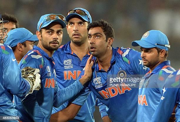 Indian bowler Ravichandran Ashwin celebrates with teammates Virat Kohli Yuvraj Singh and Suresh Raina after taking the wicket of unseen Sri Lanka...