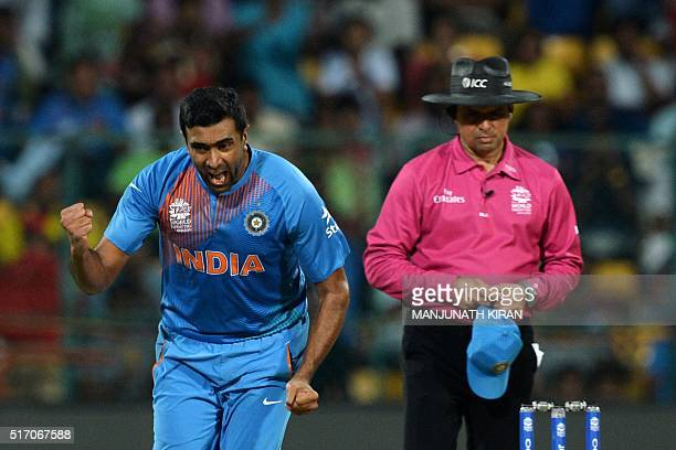 Indian bowler Ravichandran Ashwincelebrates the dismissal of Bangladesh batsman Shakib Al Hasan during the World T20 cricket tournament match between...
