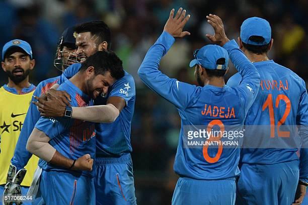 Indian bowler Suresh Rainacelebrates with teammates after taking the wicket of Bangladesh batsman Sabbir Rahman during the World T20 cricket...
