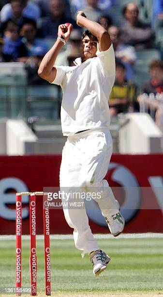 Indian bowler Umesh Yadav sends down a delivery on the third day of the first Test match between Australian and India at the Melbourne Cricket Ground...