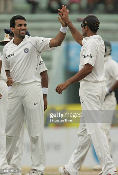 Indian bowler Zaheer Khan celebrates with Anil Kumble the wicket of Bangladesh batsman Shahriyar Nafees during the 2nd test match between India and...