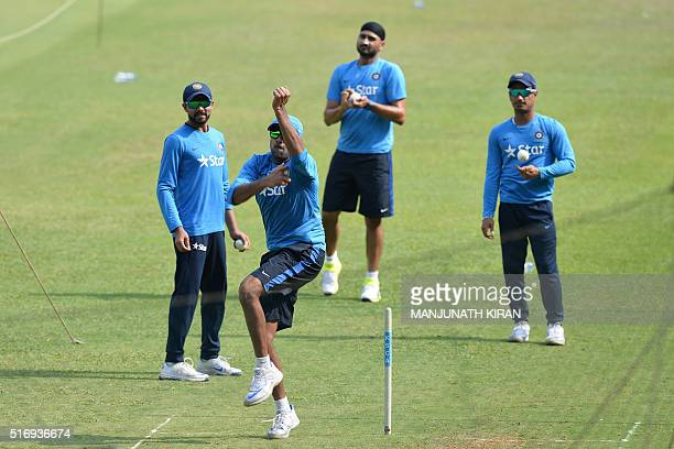 Indian bowlers Ravindra Jadeja Ravichandran Ashwin Harbhajan Singh and Pawan Negi take part in a net practice session on the eve of their match...