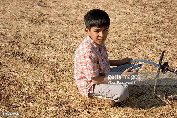 Indian boy playing with a mobile phone