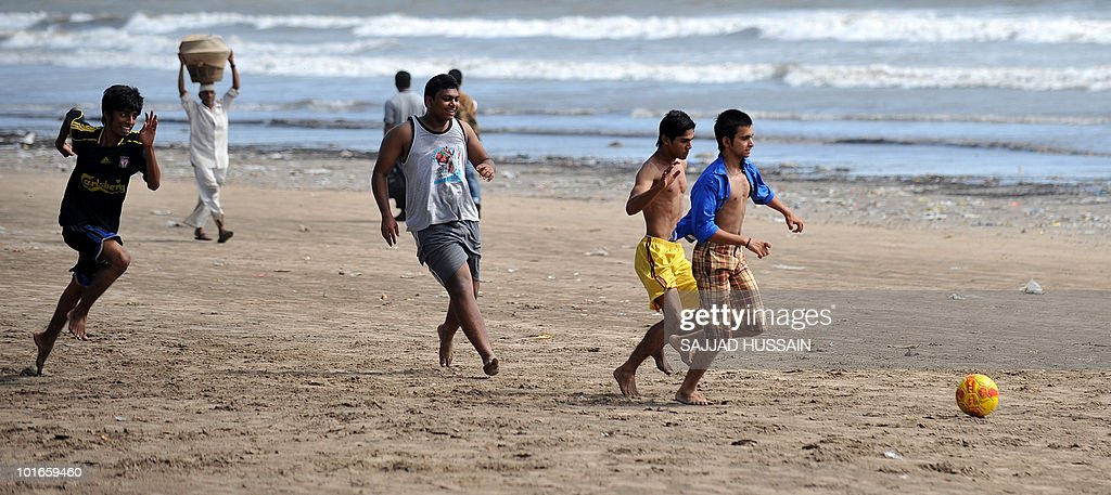 Indian boys play football on Juhu beach in Mumbai on June 6, 2010. AFP PHOTO/Sajjad HUSSAIN