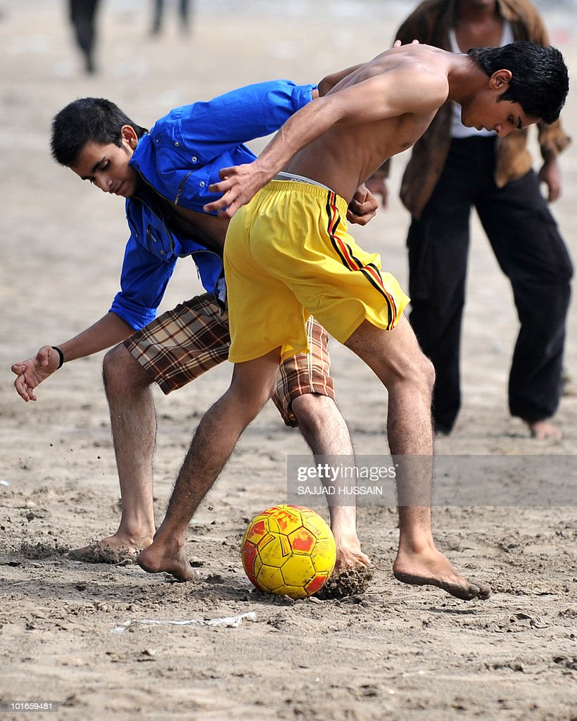 Indian boys play football on Juhu beach in Mumbai on June 6, 2010. AFP PHOTO/Sajjad HUSSAIN
