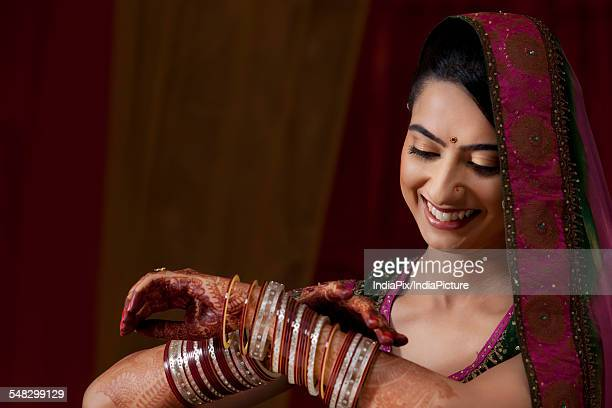 Indian bride admiring her bangles
