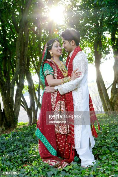 Indian Bride and Groom in the Garden with Sunburst