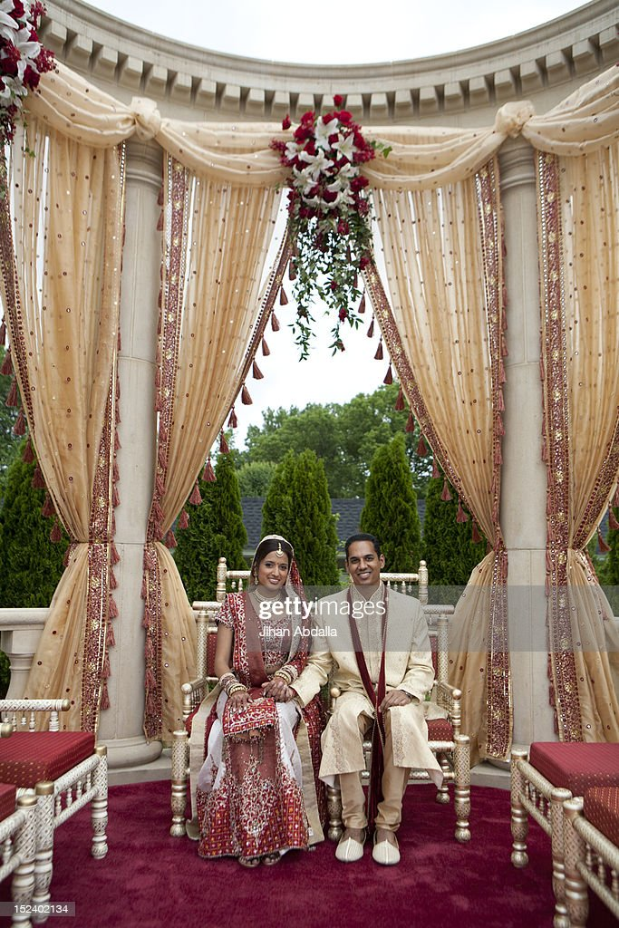 indian bride and groom in traditional clothing stock photo