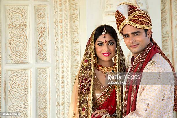 Indian bride and groom in traditional wedding dress