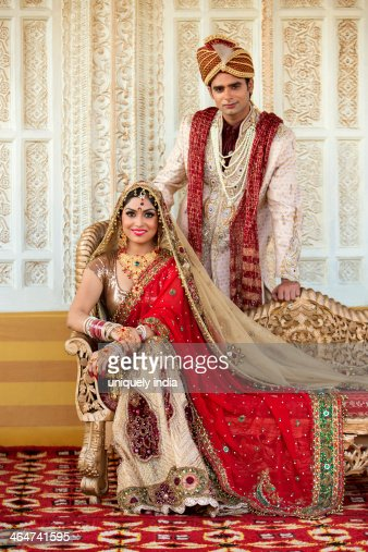 indian bride and groom in traditional wedding dress stock