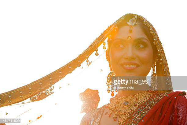 Indian bride in traditional wedding dress and posing