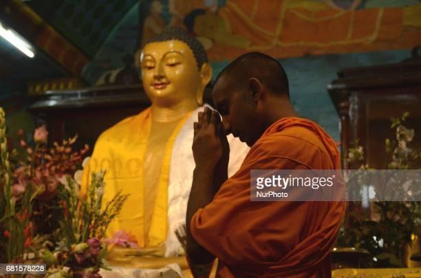 Indian Buddhist monk praying at the Buddhist temple during Buddha Purnima festival in Kolkata India on Wednesday 10th May 2017 Buddha's birthday is...