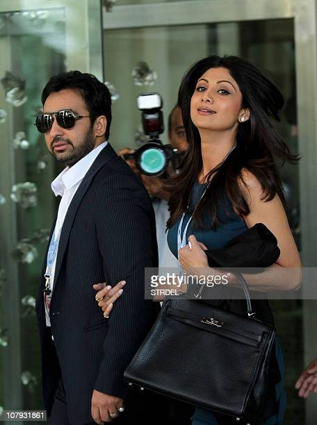 Indian businessman and coowner of 'Rajasthan Royals' Indian Premier League cricket team Shilpa Shetty walks with her husband Raj Kundra as they...