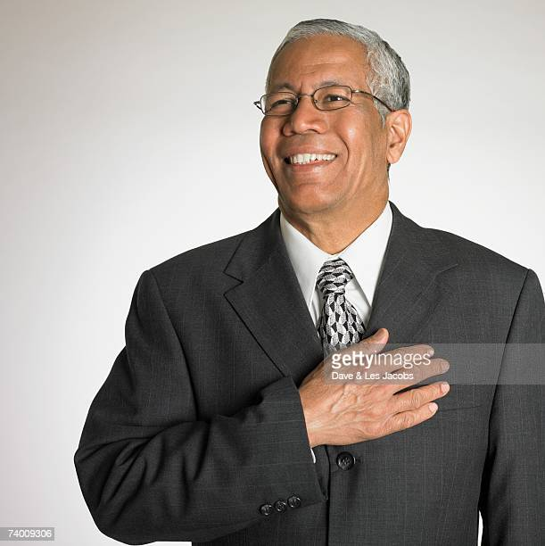 Indian businessman holding hand on heart