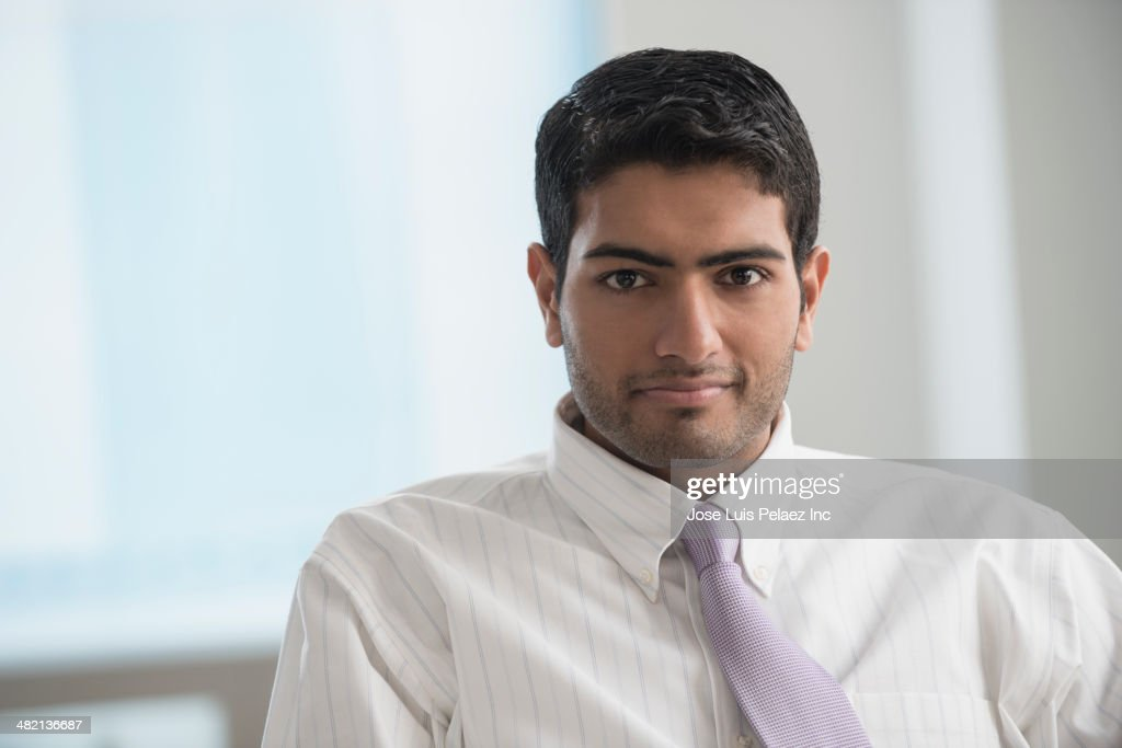 Indian businessman sitting in office