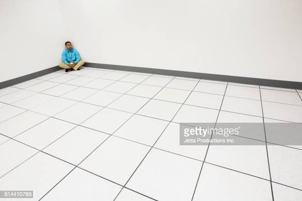 Indian businessman sitting in server room