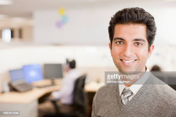 Indian businessman standing in office