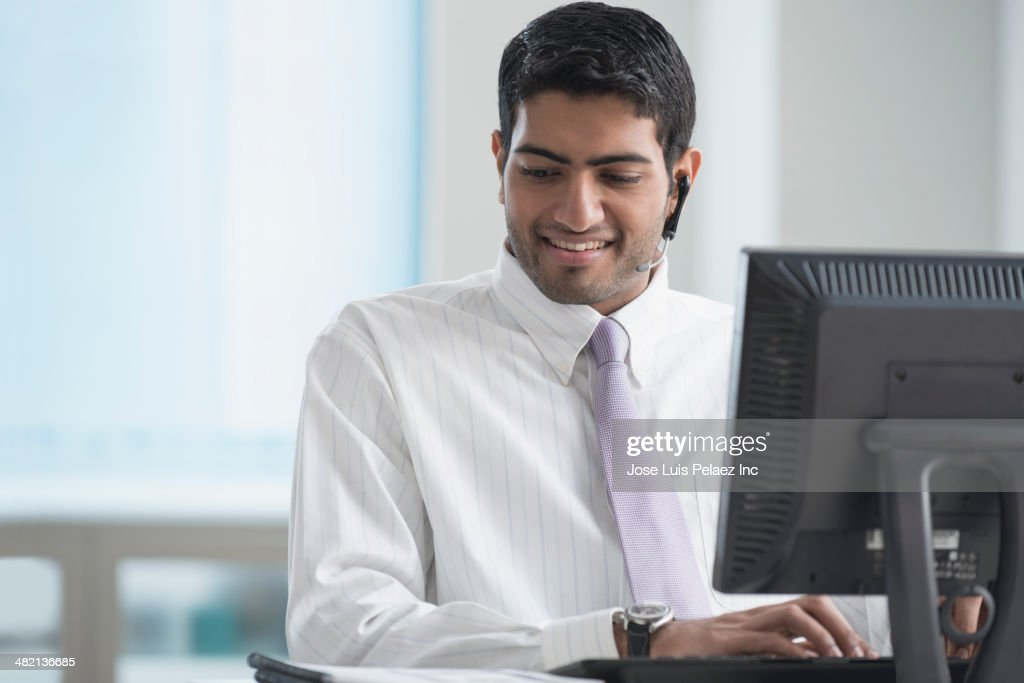 Indian businessman working at desk in office