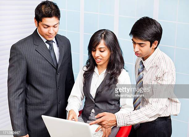 Indian Businesswoman explaining views Businessman Listening Discussing