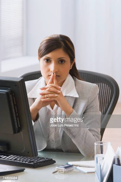Indian businesswoman sitting at desk