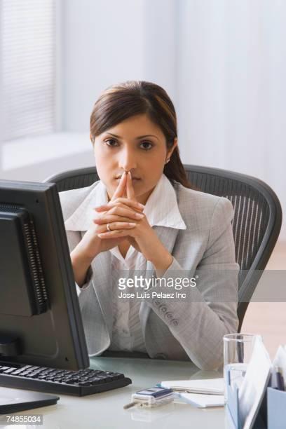 Indian businesswoman sitting at desk