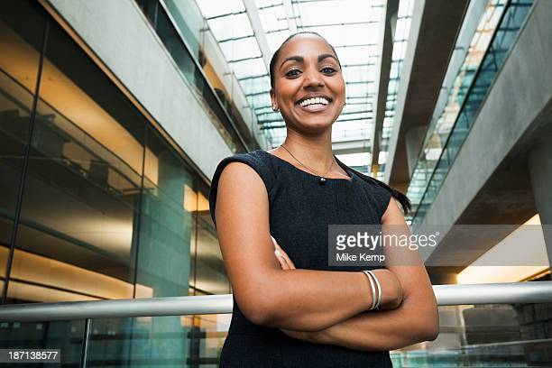 Indian businesswoman smiling in office