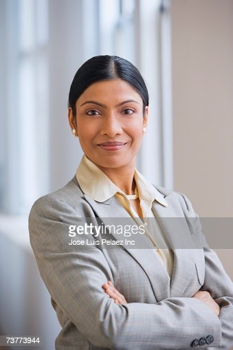 Indian businesswoman standing with arms crossed