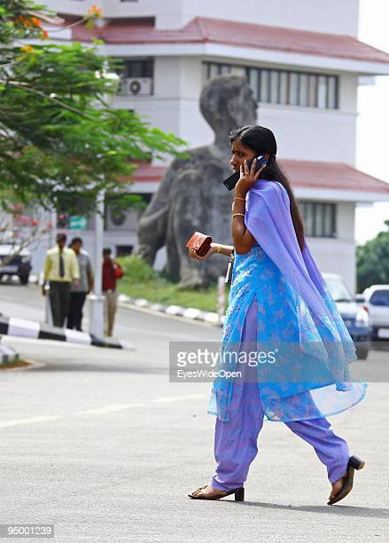 Indian businesswoman wearing a traditional saree with a mobile phone at the center of technology in Kerala called technopark where highly educated...