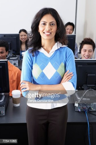 Indian businesswoman with computer service technicians in background
