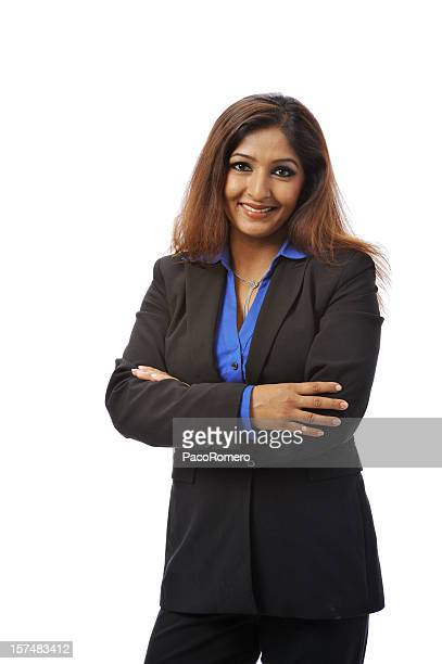 Indian businesswoman with her arms crossed and smiling