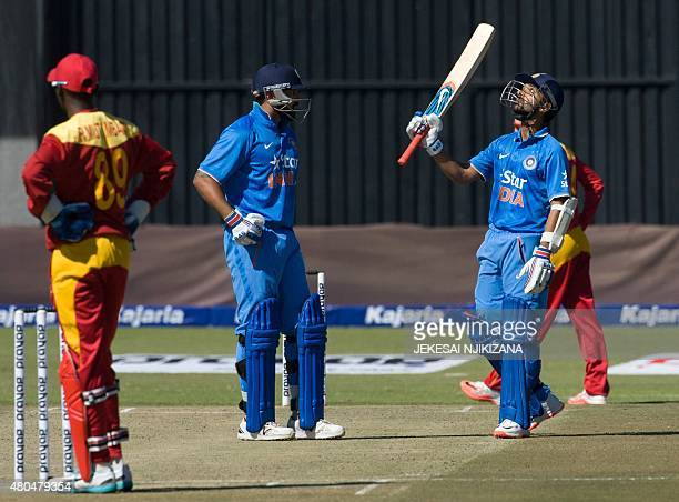 Indian captain Ajinkya Rahane celebrates 50 runs during the second game in a series of three One Day International cricket match between India and...