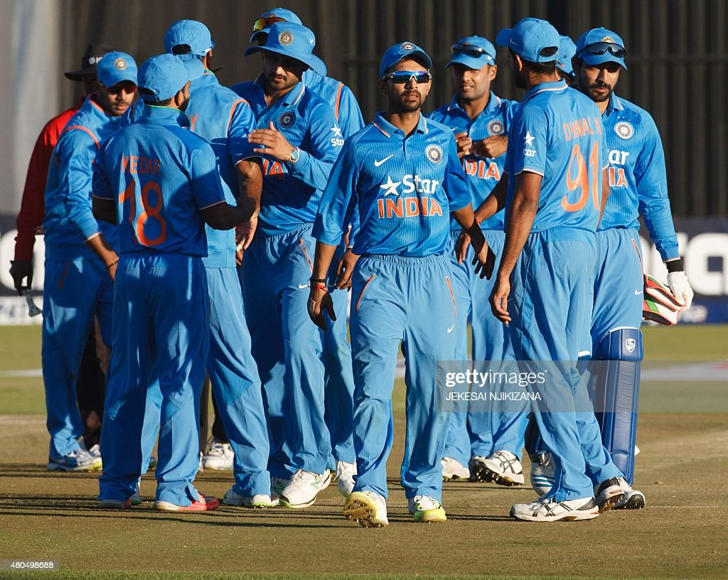 Indian captain Ajinkya Rahane leads his team off the field after winning the second game in a series of 2 ODI cricket matches between India and host...