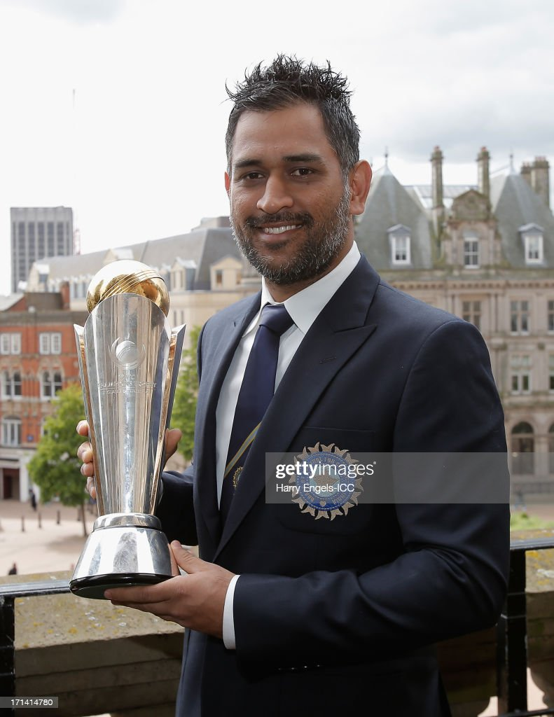 Indian captain MS Dhoni poses with the Champions Tophy during a photocall for the winners of the ICC Champions Trophy on June 24, 2013 in Birmingham, England.