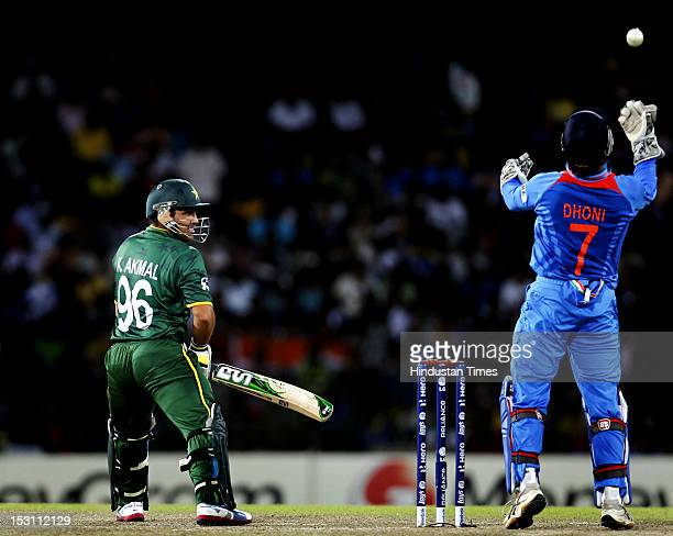 Indian Captain MS Dhoni takes a catch off Pakistani player Kamran Akmal during the ICC T20 World Cup Super Eight group 2 cricket match between India...