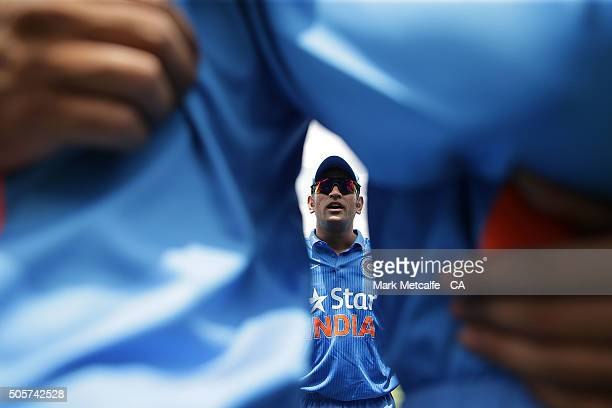 Indian captain MS Dhoni talks in a team huddle prior to the Victoria Bitter One Day International match between Australia and India at Manuka Oval on...