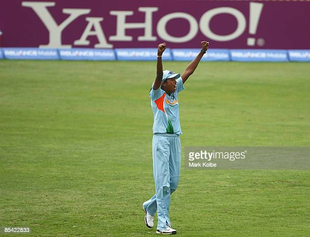 Indian captain Jhulan Goswami of India celebrates after her team defeated Australia in the ICC Women's World Cup 2009 Super Six match between...