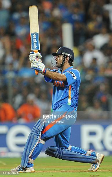 Indian captain Mahendra Singh Dhoni hits a six to give India victory over Sri Lanka in the ICC Cricket World Cup 2011 final played at The Wankhede...