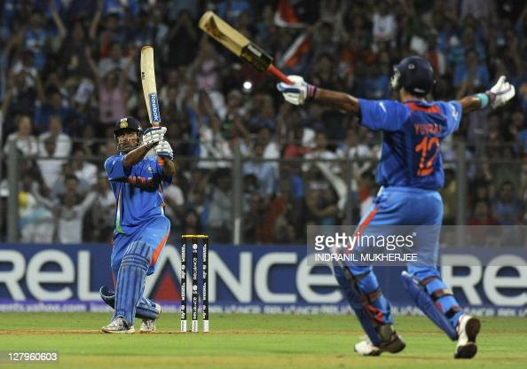 Indian captain Mahendra Singh Dhoni hits a six to win against Sri Lanka as teammate Yuvraj Singh reacts during the Cricket World Cup 2011 final at...