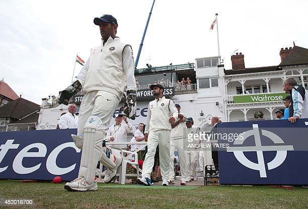 Indian captain Mahendra Singh Dhoni leads his team out for the third days play in the first cricket Test match between England and India at Trent...