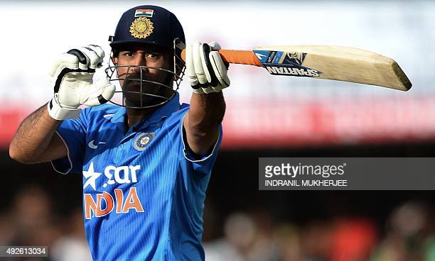 Indian captain Mahendra Singh Dhoni looks back after playing a shot during the second one day international cricket match between India and South...