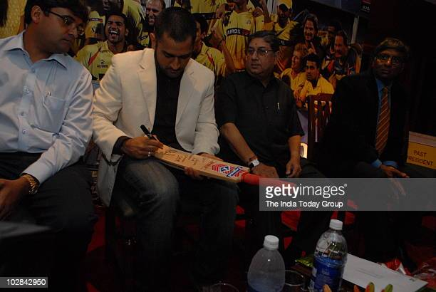 Indian captain Mahendra Singh Dhoni signs a bat during the felicitation ceremony Dhoni joined the elite group of Honorary Members of the Madras...