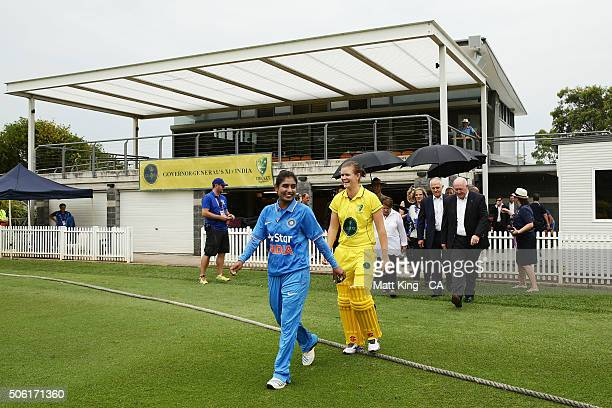 Indian captain Mithali Raj and GovernorGeneral's XI captain Jess Jonassen walk onto the field during the tour match between the GovernorGeneral's XI...