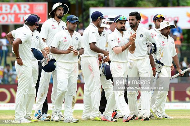 Indian captain Virat Kohli and teammates leave the ground after victory in the second Test match between Sri Lanka and India at the P Sara Oval...