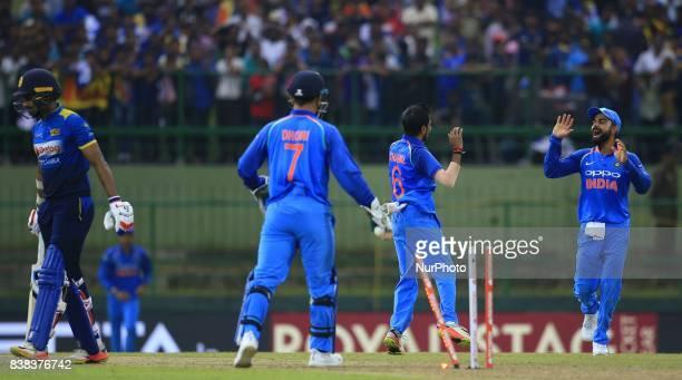 Indian captain Virat Kohli and Yuzvendra Chahal celebrate after taking the wicket of Sri Lanka's Danushka Gunathilaka during the 2nd One Day...