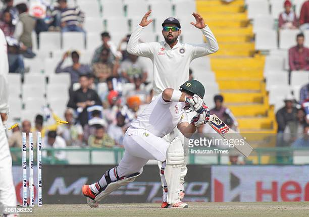 Indian captain Virat Kohli appealing against South African player Dean Elgar during the third day of first Test match been played at PCA Stadium on...