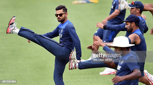 Indian captain Virat Kohli leads the team in stretching exercises during cricket training at the Sydney Cricket Ground on January 5 2015 Australia...