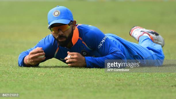 Indian captain Virat Kohli takes the catch to dismiss Sri Lanka's Dilshan Munaweera during the final one day international cricket match between Sri...