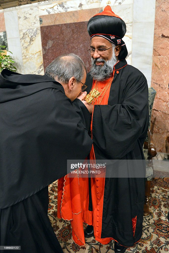 Indian cardinal Baselios Cleemis Thottunkal greets visitors druing the courtesy visit after being appointed by the pontif on November 24, 2012 at the Apostolico palace at the Vatican. Six non-European prelates are set to join the Catholic Church's College of Cardinals, a move welcomed by critics concerned that the body which will elect the future pope is too Eurocentric. AFP PHOTO / VINCENZO PINTO
