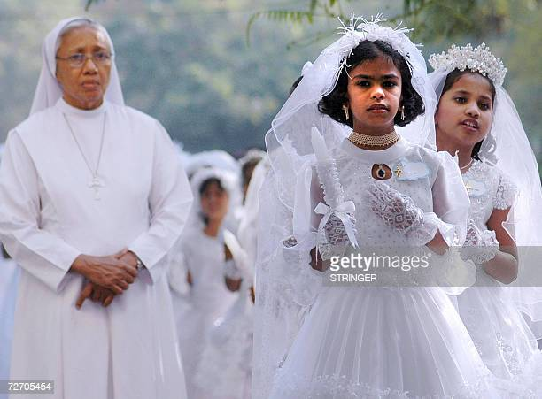 Indian Catholic girls line up before entering the St Mary's Church to receive their first communion in Secunderabad in India's southern state of...